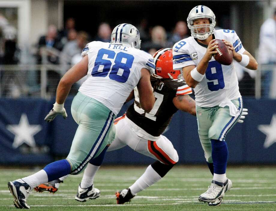 Dallas right tackle Doug Free (68) tries to help against pressure on quarterback Tony Romo from Cleveland's Jabaal Sheard (97) during Sunday's overtime win at Cowboys Stadium. Photo: Brandon Wade, Associated Press / FR168019 AP
