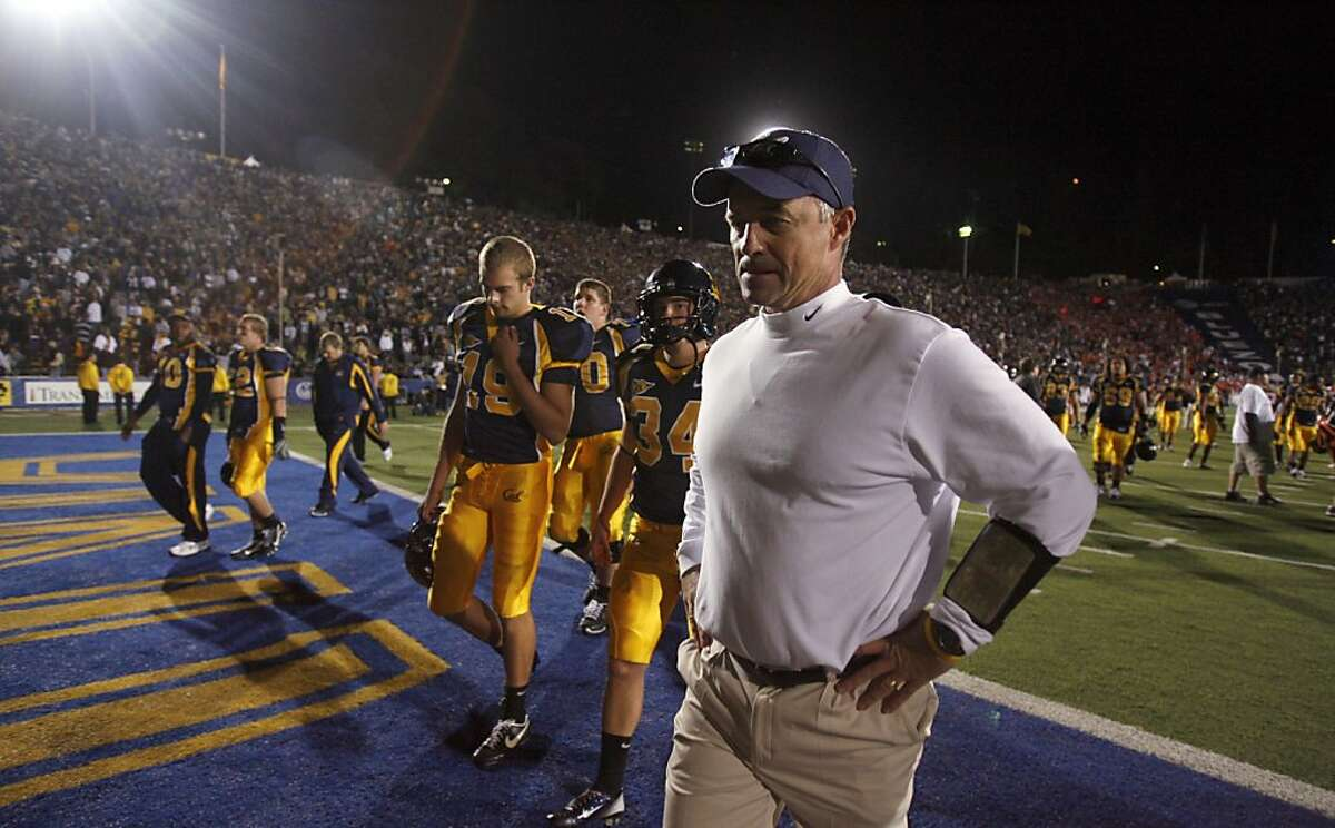 A dejected Cal team and coach Jeff Tedford walk off the field after being defeated by Oregon State on Oct. 13, 2007.