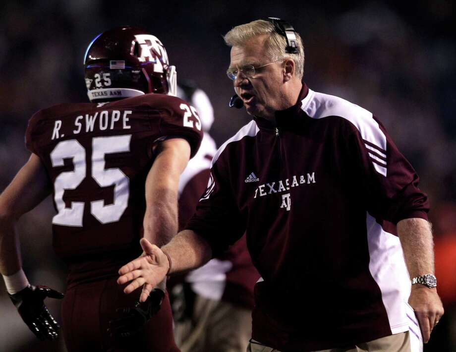 Former Texas A&M coach Mike Sherman greets receiver Ryan Swope and other players after A&M scored in last season's loss to longtime rival Texas, an outcome that, if reversed, might have led to Sherman's remaining the Aggies' coach. Photo: Brett Coomer, HC Staff / © 2011 Houston Chronicle