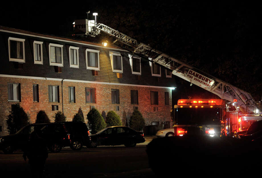 Danbury firefighters were called to the scene of a fire at Colonial Gardens, a residential building of 30 condominium units, on Wildman Street in Danbury on Tuesday, Nov. 20, 2012. No injuries were reported. Photo: Jason Rearick / The News-Times