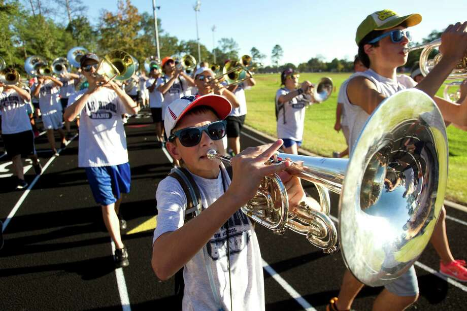 Colton Ward plays his mellophone as he marches around the track at Oak Ridge High School with the rest of the band while preparing to march in the Macy's Thanksgiving Day Parade Tuesday, Nov. 6, 2012, in Conroe. To get ready for the 2 1/2 mile parade route in New York City, the Oak Ridge band marches around the school's track the same distance each day. Photo: Brett Coomer, Houston Chronicle / © 2012 Houston Chronicle