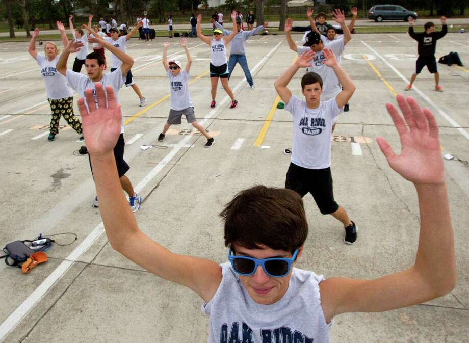 Oak Ridge High School Band members Matthew Henry does jumping jacks during warm ups while the band prepares to march in the Macy's Thanksgiving Day Parade Tuesday, Nov. 13, 2012, in Conroe. Photo: Brett Coomer, Houston Chronicle / © 2012 Houston Chronicle