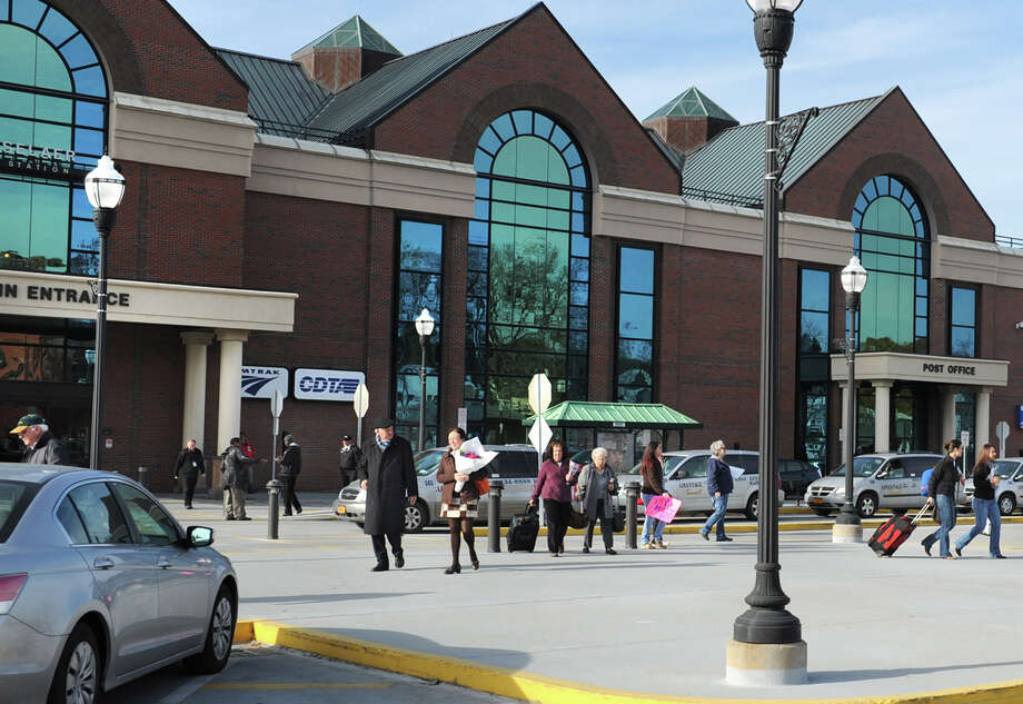 Passengers head to cars and buses after arriving at the Albany-Rensselaer Train Station Tuesday, Nov. 20, 2012 in Rensselaer, N.Y. People are traveling back home or to relatives for the Thanksgiving Holiday. (Lori Van Buren / Times Union) Photo: Lori Van Buren