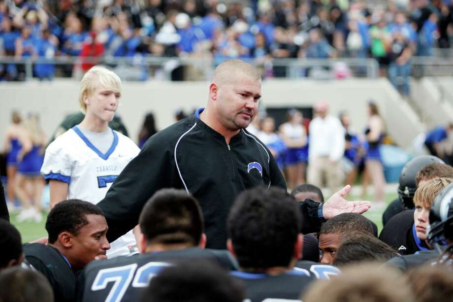 Clear Springs head coach, Clint Hartman, addresses his team following a high school football playoff game between the Clear Springs High School Chargers and the Port Arthur Memorial Titans, Saturday, November 19, 2011 at Stallworth Stadium in Baytown, Texas. PA Memorial won 38-35. (Todd Spoth / For The Chronicle) Photo: TODD SPOTH, Freelance / Todd Spoth