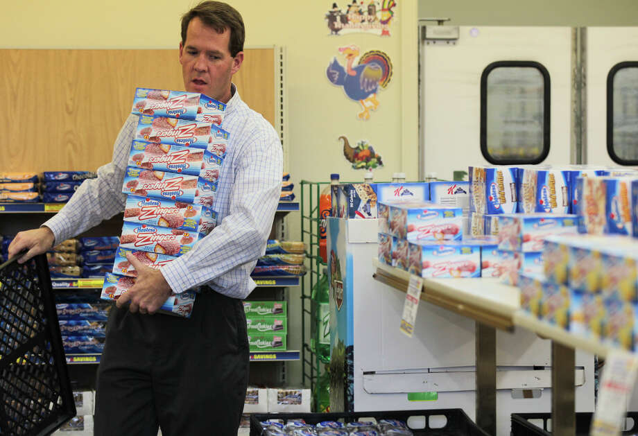 In this photo taken Friday, Nov. 16, 2012, Scott Hubbard of Chico, Calif., loads up on Hostess Zingers at the Hostess store in Redding, Calif., shortly after it was announced Hostess was going out of business. Hubbard said he was going to use them as an office fundraiser going to an organization to help buy Christmas gifts for troops. (AP Photo/Record Searchlight, Andreas Fuhrmann) Photo: Andreas Fuhrmann