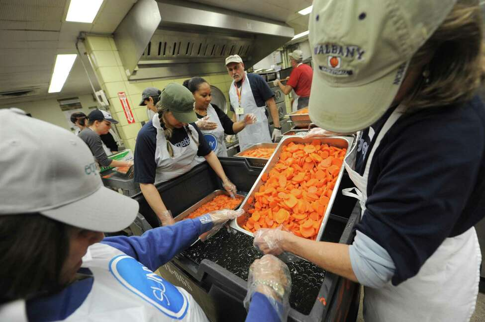 Volunteer chef Mark McDonald, center,oversees a group of volunteers prepping carrots for the Equinox Thanksgiving Dinner at the Empire State Plaza in Albany, NY Tuesday Nov. 20, 2012. (Michael P. Farrell/Times Union)