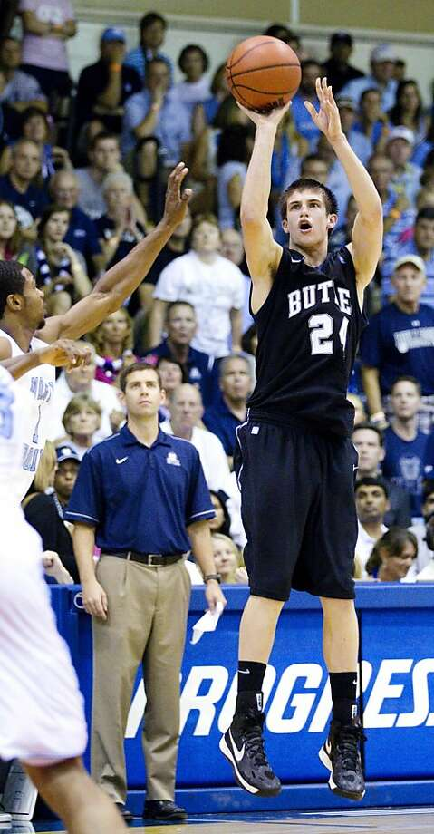 Kellen Dunham shoots a three-pointer in the second half of Butler's 82-71 win over UNC. Photo: Eugene Tanner, Associated Press