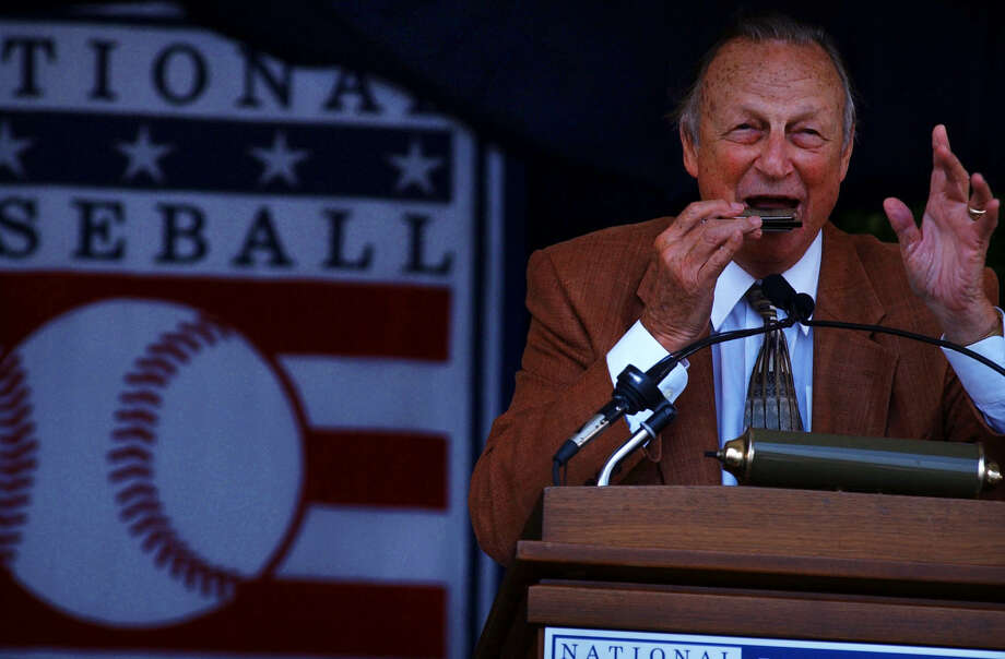 "Times Union Staff photograph by Philip Kamrass -- St. Louis Cardinals Hall of Fame outfielder Stan Musial plays ""Take Me Out to the Ballgame"" on his harmonica  during Sunday's National Baseball Hall of Fame induction  ceremony at the Clark Sports Center in Cooperstown, NY July 28, 2002. Photo: PHILIP KAMRASS"