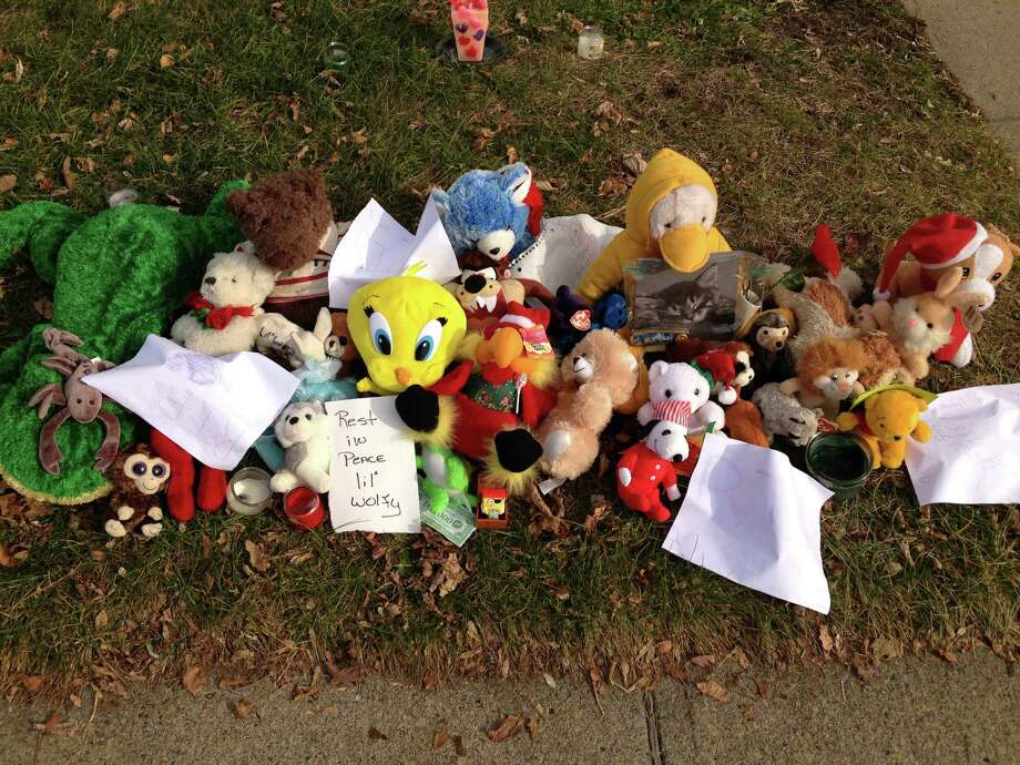 A make-shift memorial was created for 5-year-old Gary Carpenter III outside his on Mission St. home in Glens Falls. Jennifer Mattison, 23, was indicted on felony counts of reckless endangerment, hindering prosecution and misdemeanor endangering the welfare of a child in connection with the death of her son. In addition to murder charge, Mattison?s boyfriend, Brandon Warrington, 24, was charged with manslaughter and endangering the welfare of a child.  (Fitzgerald, Bryan Fitzgerald / Times Union)