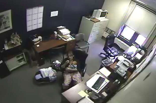 Jennifer Mattison, 23, cradles her newborn child in a office at the Glens Falls Police Department where investigators questioned her about the death of her 5-year-old son, Gary Carpenter III, who was beaten to death on Thursday. The photograph was taken from a video police made of the interview. (Warren County District Attorney's office)
