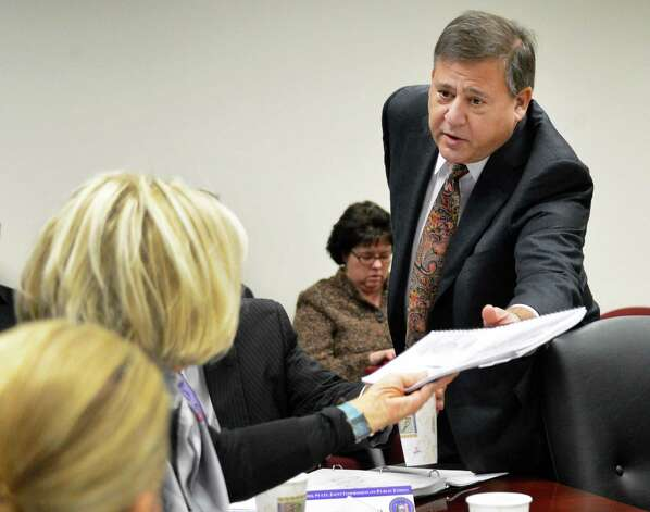 Ethics compliance consultant David Grandeau hands a complaint against state Comptroller Tom DiNapoli to NY State's ethics commission chair Janet DiFiore during the commission's Tuesday meeting in Albany Nov. 20, 2012.  (John Carl D'Annibale / Times Union) Photo: John Carl D'Annibale / 00020207A