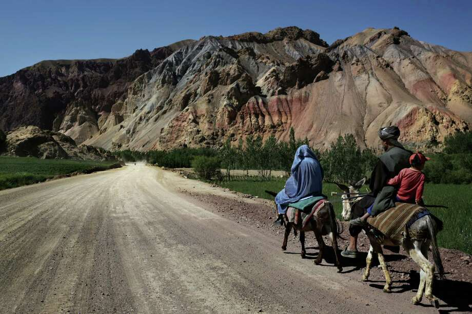A family rides donkeys on a peaceful-looking province road. Afghan and Western analysts consider the byways unsafe, especially for government officials. Photo: MAURICIO LIMA, STR / NYTNS