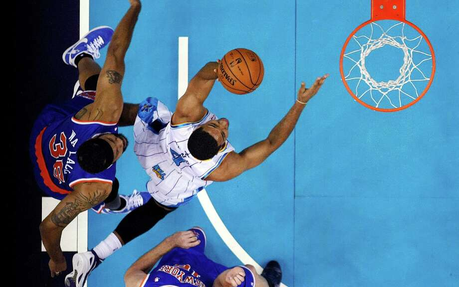 New Orleans Hornets guard Xavier Henry (4) drives to the basket in front of New York Knicks forward Rasheed Wallace (36) in the first half of an NBA basketball game in New Orleans, Tuesday, Nov. 20, 2012. (AP Photo/Gerald Herbert) Photo: Gerald Herbert
