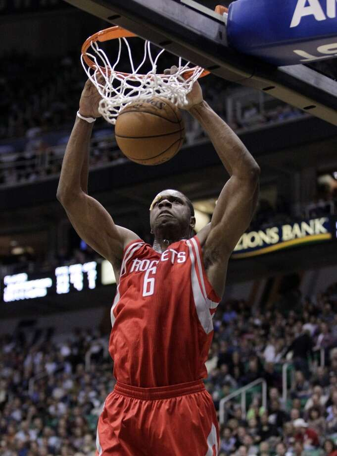 Rockets rookie forward Terrence Jones slams a dunk home. (Rick Bowmer  / Associated Press)