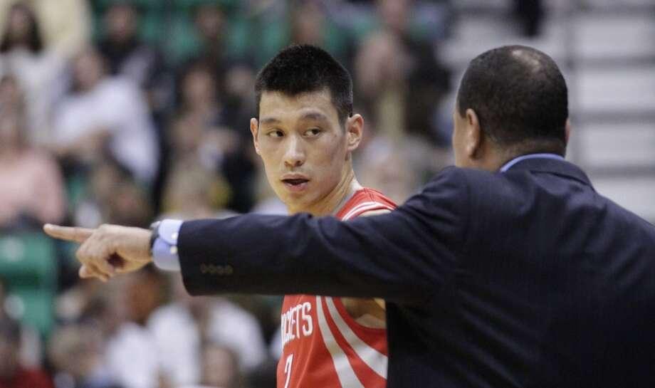 Rockets acting coach Kelvin Sampson instructs guard Jeremy Lin. (Rick Bowmer / Associated Press)