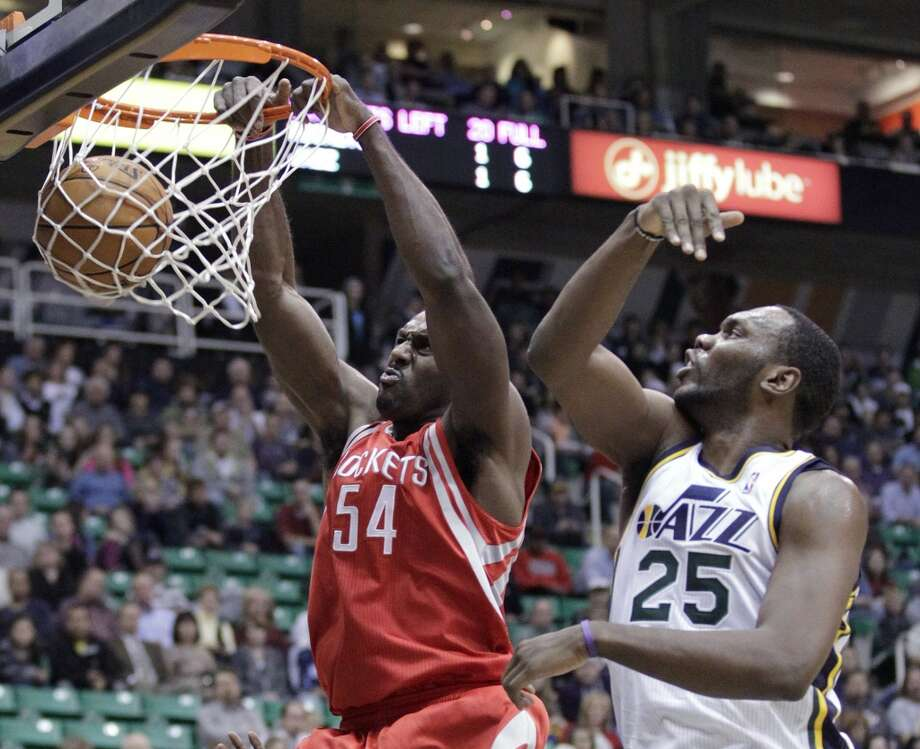 Rockets forward Patrick Patterson gets two points the easy way. (Rick Bowmer  / Associated Press)