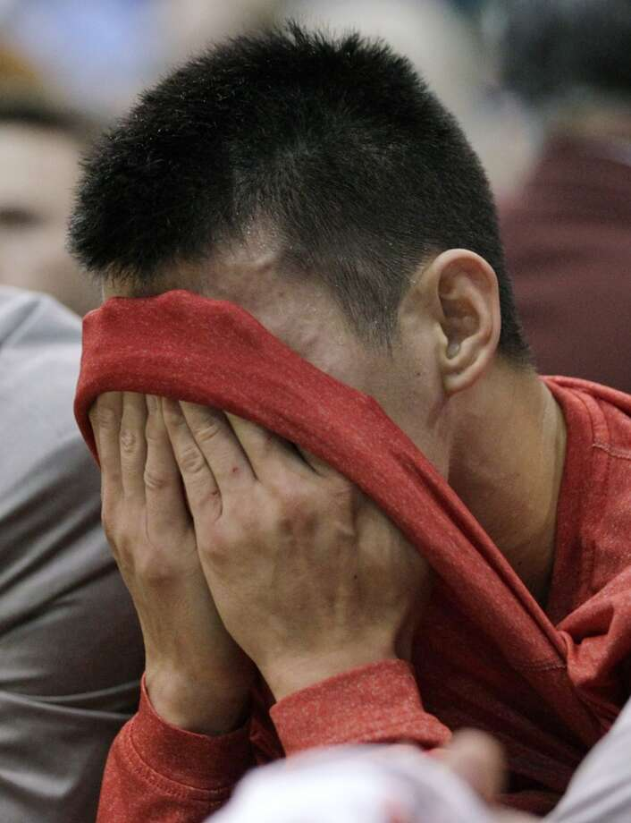 Rockets guard Jeremy Lin wipes sweat from his face. (Rick Bowmer  / Associated Press)