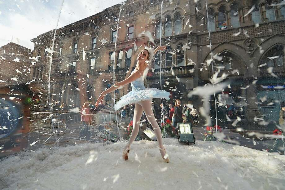 Claire Robertson from Scottish Ballet, poses dressed as the Good Snow Flake inside a life size snow globe on Buchanan Street during a promotion for Scottish Ballet's festive production of The Nutcracker on November 20, 2012 in Glasgow,Scotland. The Nutcracker opens at the Theatre Royal on December the 8th, the production delves deep into the darker reaches of Hoffmann's original tale in a fresh and vivid retelling of the famous Christmas story. Photo: Jeff J Mitchell, Getty Images