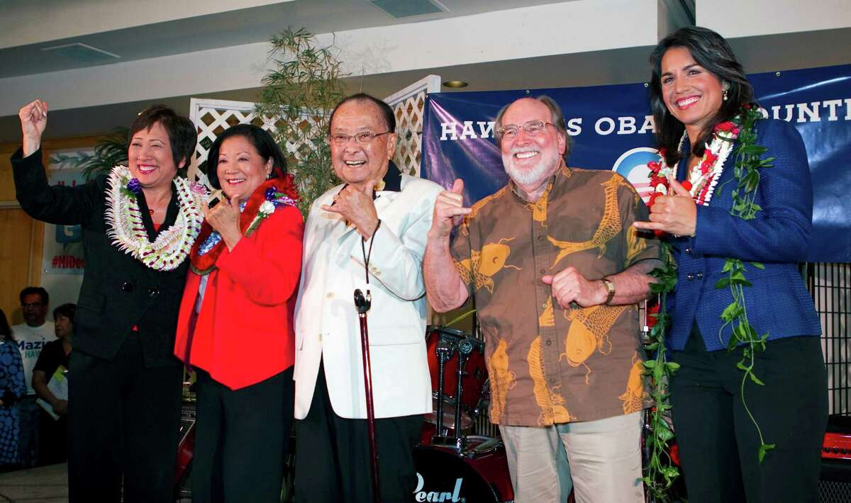 From left, U.S. Rep. Colleen Hanabusa, U.S. Rep. Mazie Hirono, U.S. Sen. Daniel Inouye, Hawaii Gov. Neil Abercrombie and candidate Tulsi Gabbard celebrate their election victories at the Japanese Cultural Center, Tuesday, Nov. 6, 2012 in Honolulu. (AP Photo/Marco Garcia)