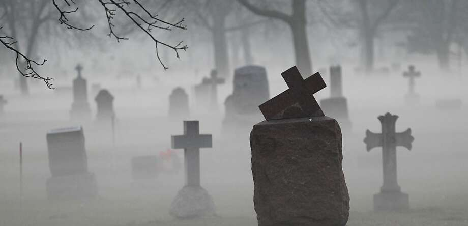 Fog descends upon Calvary Catholic Cemetery in a section where the headstones date back to the beginning of the 20th Century Tuesday, Nov. 20, 2012 in Evanston, Ill. Temperatures have been unseasonably warm with a cold front approaching the greater Chicago area by Saturday. Photo: Charles Rex Arbogast, Associated Press
