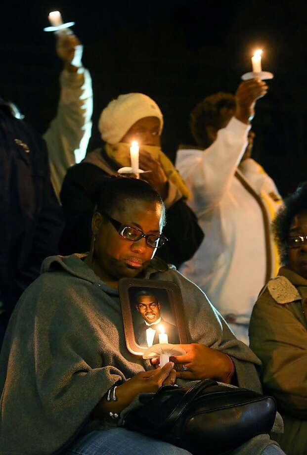 Paula Champion, the aunt of Robert Champion, holds his portrait during a candlelight vigil to mark the one-year anniversary of her nephew's death, at the Community Achievement Center in Decatur, Ga., on Monday, Nov. 19, 2012. Authorities have charged more than a dozen fellow band members in the death of Champion, a Florida A&M drum major who died after being beaten during a hazing ritual. Photo: Curtis Compton, Associated Press