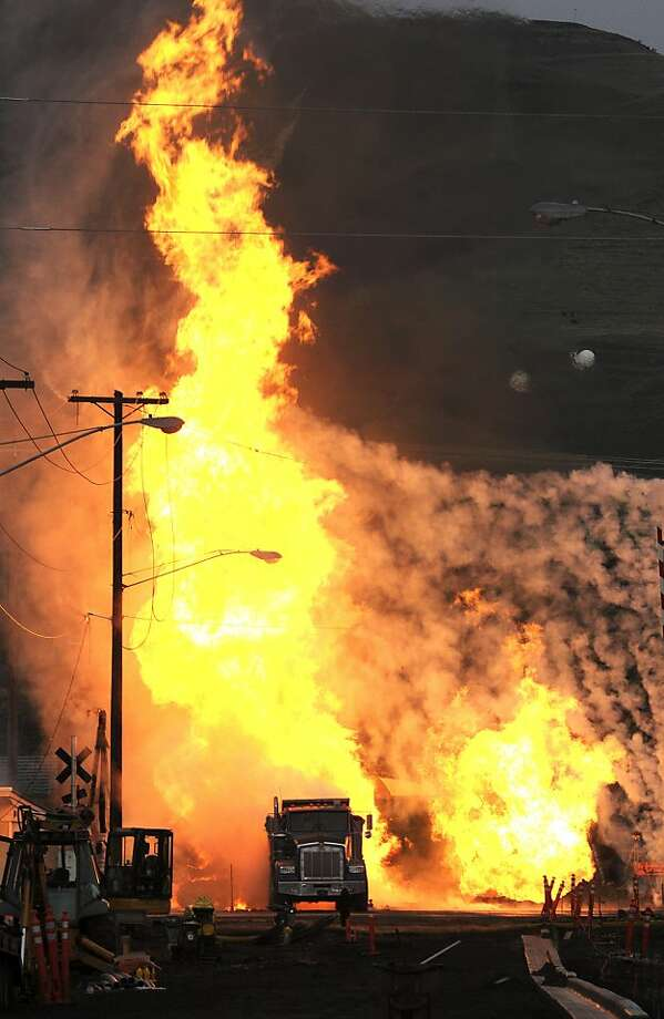 A towering column of flames rises into the air above Fifth Street in downtown Lewiston, Idaho, Monday, Nov. 19, 2012, after an excavator hit a gas line. Photo: Kyle Mills, Associated Press