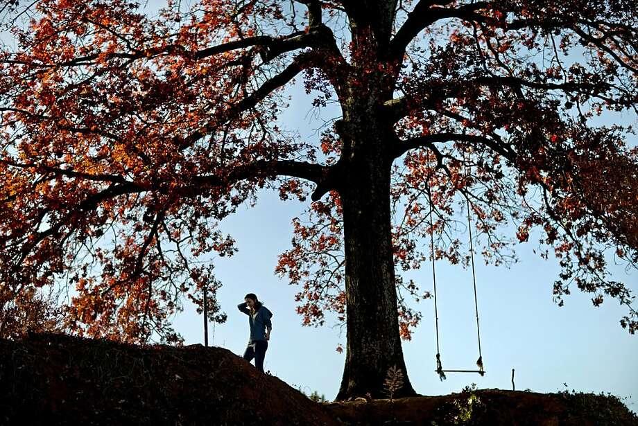 Alex Cummings, 15, of Decatur, Ga., walks atop a hill as the sun begins to set along the Atlanta Beltine trail, Tuesday, Nov. 20, 2012, in Atlanta. Photo: David Goldman, Associated Press