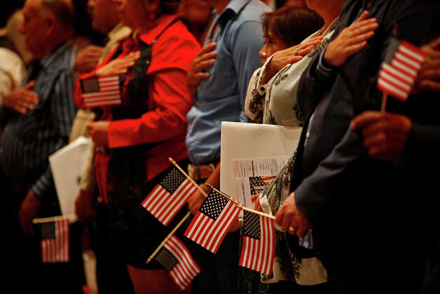 New U. S. citizens participate in their Naturalization Ceremony in Laurie Auditorium at Trinity University in San Antonio on Tuesday, Nov. 20, 2012. Photo: Lisa Krantz, San Antonio Express-News / © 2012 San Antonio Express-News