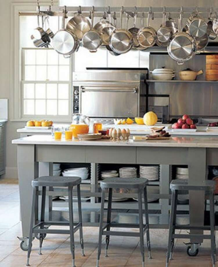 The icon of holiday decorating, Martha Stewart, has a clean and contemporary kitchen. While this is probably just one of her many homes, it doesn't have the New England country feel one would expect from Ms. Martha. By the look of all those dishes in the island shelf and the commercial grade oven, you know she's ready to throw feed the masses. Notice the kitchen island is on rolling casters? A novel idea to make way for dancing or putting an extra table down for seating. (curbed.com)