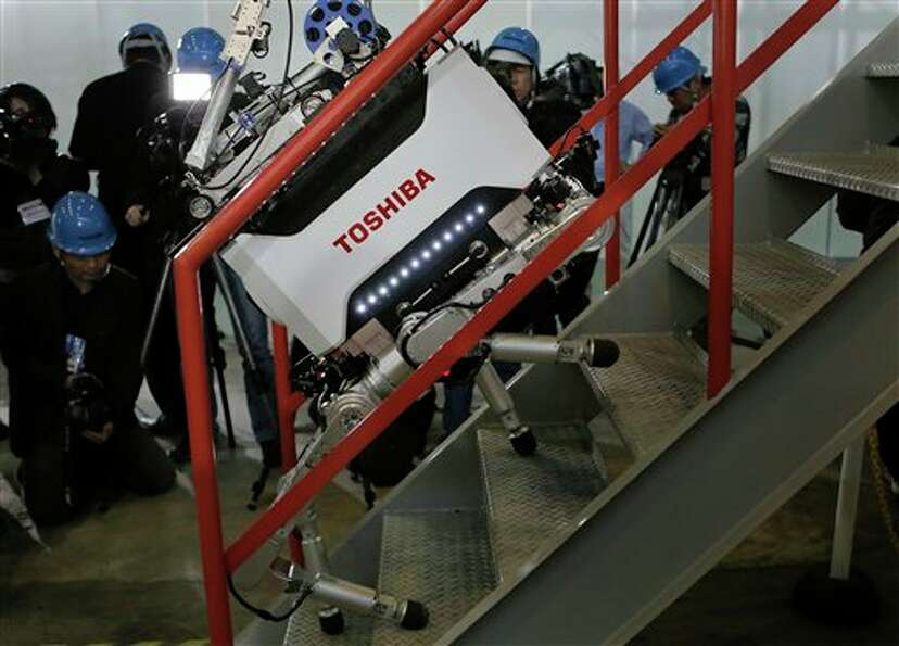 Toshiba Corp.'s nuclear Inspection robot climbs stairs during a demonstration at a Toshiba factory i