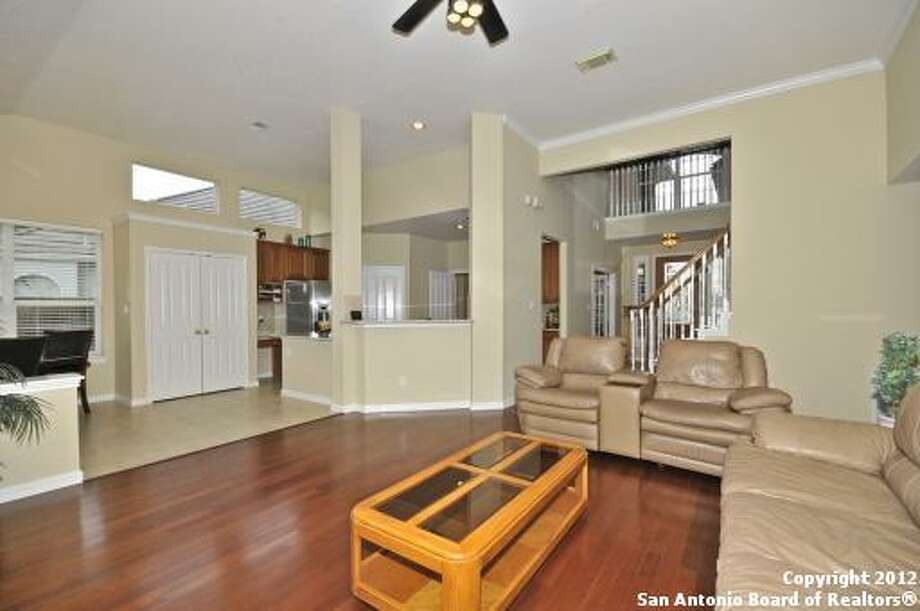 The family room adjoins the kitchen as well, preserving an open, unobstructed feel throughout the ground floor.