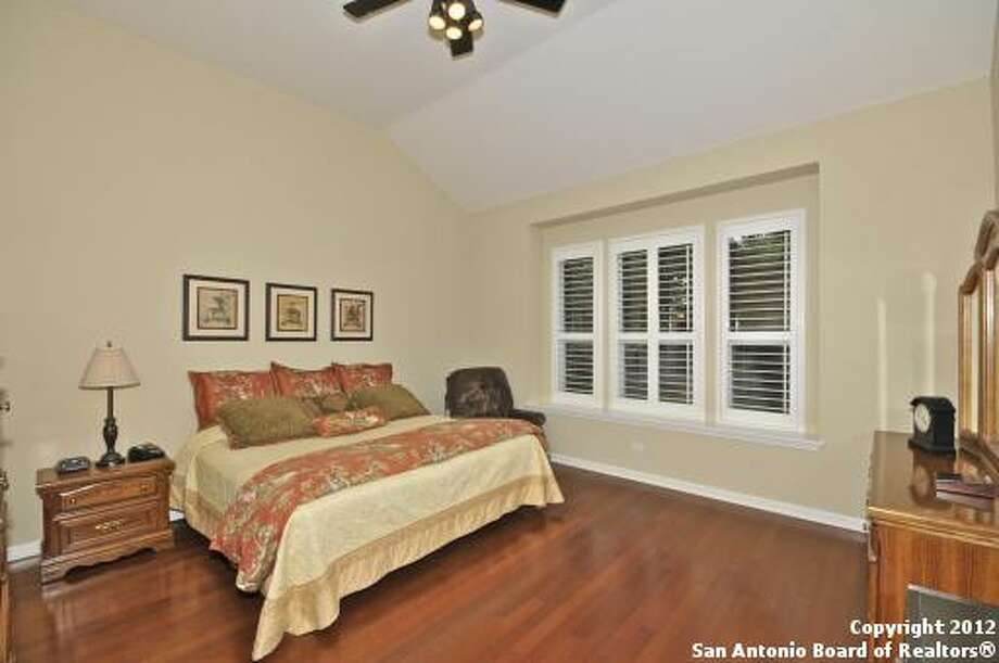 High ceilings, ample space and cherry wood floors are highlights of the master bedroom.