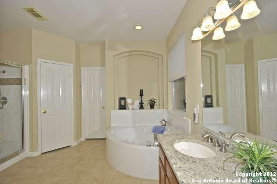 A granite countertop is in the master bathroom as well. It also has a soaking tub and separate shower stall.