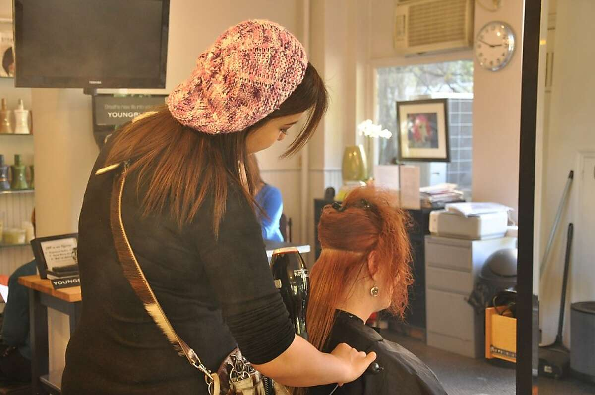 A stylist in a New York City salon uses a hair-straightening treatment that does not release formaldehyde.