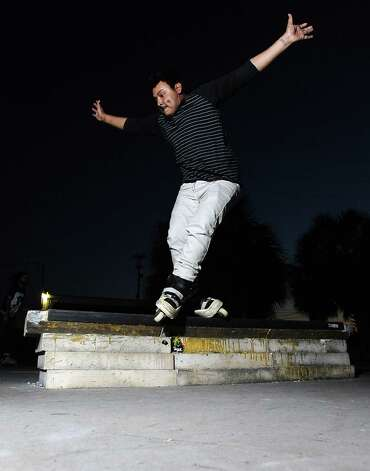 Juan Rodriguez, 24, rollerblades at a local skate spot on 4th Street in Beaumont on November, 20, 2012. Photo taken: Randy Edwards/The Enterprise