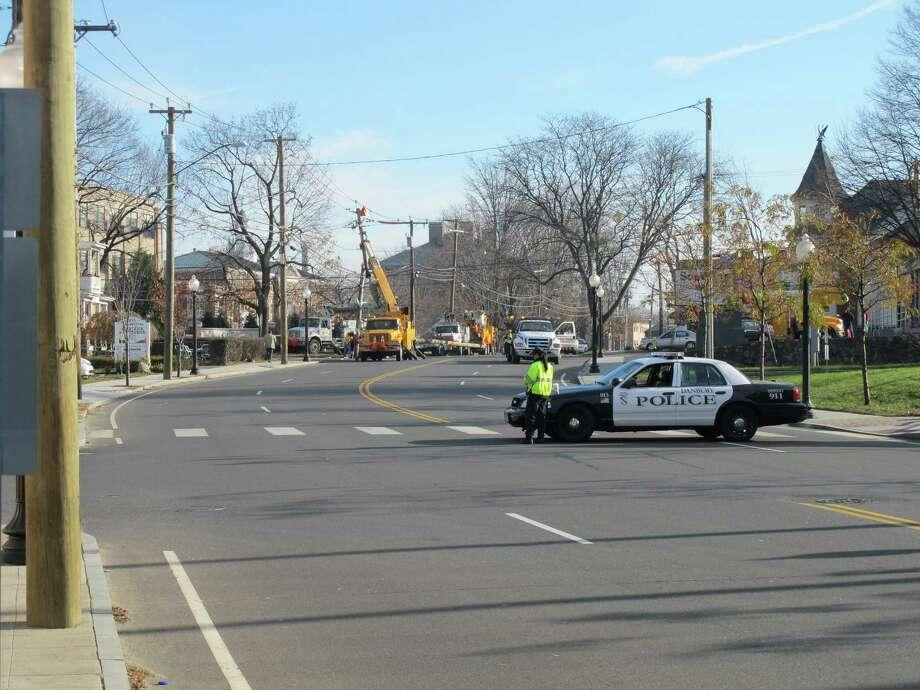 Crews work to clear the scene of a single-car crash near WestConn's Midtown campus on Wednesday, Nov. 21, 2012. Photo: Libor Jany