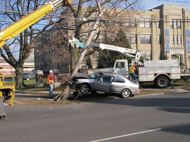 Crews work to clear the scene of a single-car crash near WestConn's Midtown campus on Wednesday, Nov. 21, 2012. Photo: Libor Jany