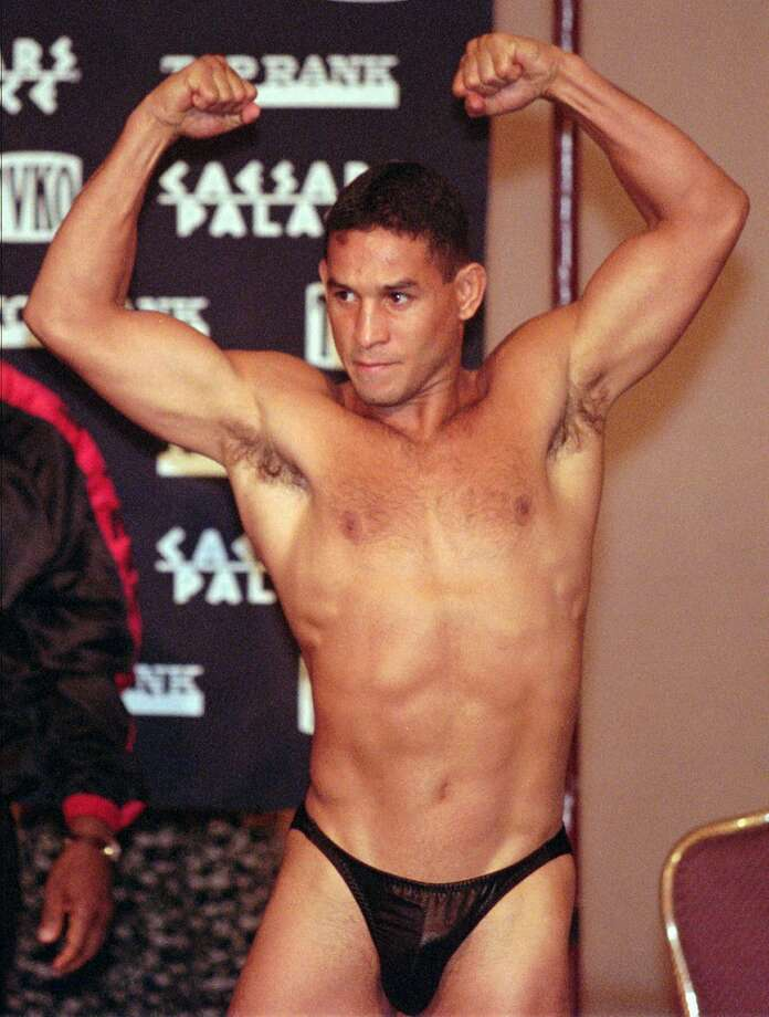 The never-shy Hector Camacho flexes for the crowd prior to weighing in Sept. 12, 1997, in Las Vegas, prior to his fight against Oscar De La Hoya. Camacho, who last fought in 2010, finished with a career record of 79-6-3 (38 KOs). He ducked no fighter and was never knocked out in the ring. Photo: JACK DEMPSEY, AP / AP