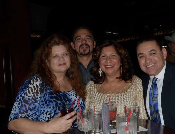 Friends Judy Solis (from left), Lupe Solis, Maggie Johnson and Jose Bonilla (cq) spend their Friday night at Raffles on November 16, 2012. Robin Johnson Photo: Robin Johnson