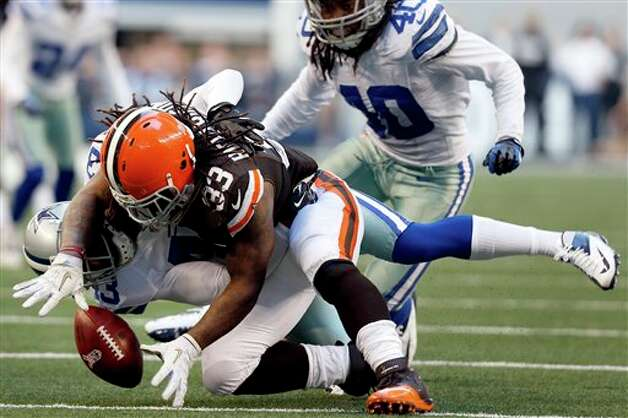 Cleveland Browns running back Trent Richardson (33) loses control of the ball after being tackled by Dallas Cowboys' Gerald Sensabaugh (43) as Danny McCray (40) watches in the second half of an NFL football game, Sunday, Nov. 18, 2012, in Arlington, Texas. Richardson recovered his own fumble on the play. (AP Photo/Sharon Ellman) Photo: Sharon Ellman, Associated Press / FR170032 AP