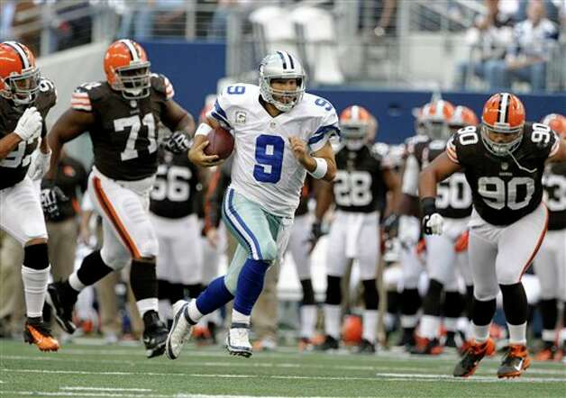 Dallas Cowboys quarterback Tony Romo (9) scrambles under pressure from =tc97, from left, Ahtyba Rubin (71) and Billy Winn in the second half of an NFL football game Sunday, Nov. 18, 2012 in Arlington, Texas. (AP Photo/Brandon Wade) Photo: Brandon Wade, Associated Press / FR168019 AP