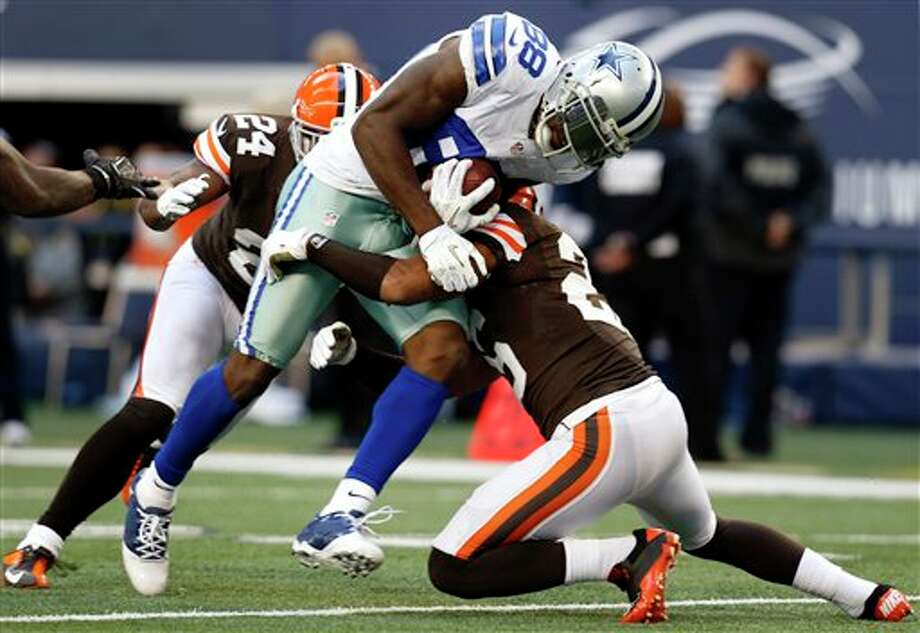 Cleveland Browns cornerback Trevin Wade (26) and Sheldon Brown (24) combine to stop Dallas Cowboys wide receiver Dez Bryant (88) in the second half of an NFL football game, Sunday, Nov. 18, 2012, in Arlington, Texas. (AP Photo/Sharon Ellman) Photo: Sharon Ellman, Associated Press / FR170032 AP