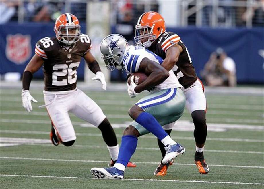 Dallas Cowboys wide receiver Dez Bryant is stopped by Cleveland Browns Buster Skrine, right, as Trevin Wade (26) goes to help in the second half of an NFL football game Sunday, Nov. 18, 2012, in Arlington, Texas. (AP Photo/Brandon Wade) Photo: Brandon Wade, Associated Press / FR168019 AP