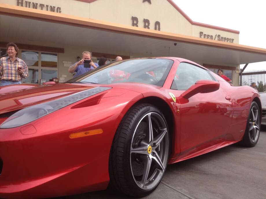 A Ferrari 458 Spider sits outside of a store in Austin. Photo: Dan X. McGraw