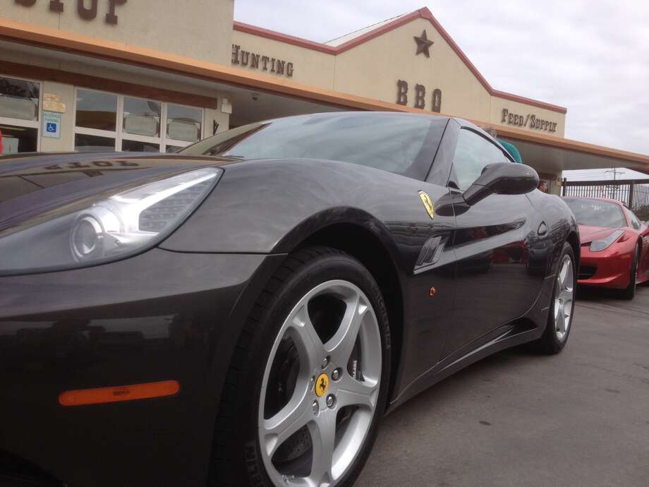 A Ferrari sits outside of a store in Austin. Photo: Dan X. McGraw