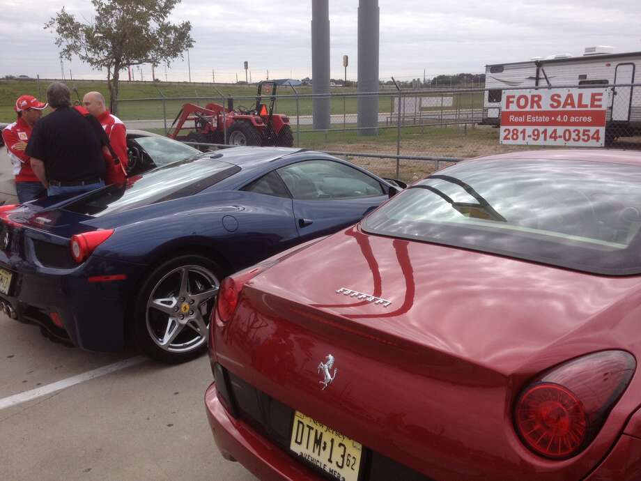 Two Ferraris sit in a parking lot outside of Austin. Photo: Dan X. McGraw