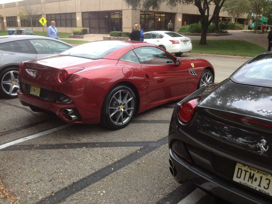 A view of a couple of Ferraris in a Houston parking lot. Photo: Dan X. McGraw