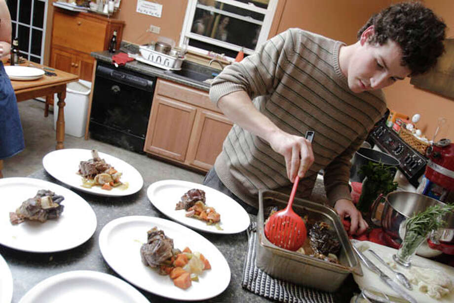New World Bistro chef Zach Welton cooks everything from bulls' testicles to osso bucco. To get the recipes click  here. Read the story  here. Photo: Photo By Suzanne Kawola/Life@Home