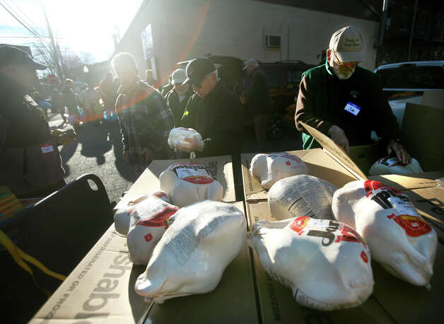 Volunteers unpack frozen turkeys as part of the annual free turkey and fixings distribution at the Black Rock Food Pantry in Bridgeport on Wednesday, November 21, 2012. Photo: Brian A. Pounds / Connecticut Post