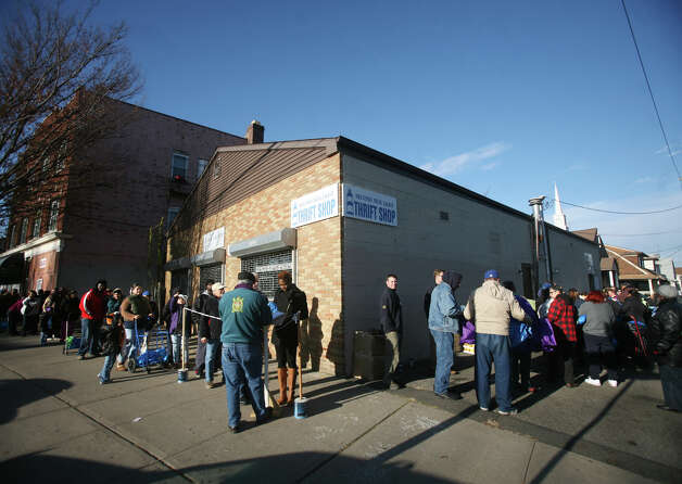 A line stretches around the block for the Black Rock Food Pantry's annual distribution of free turkeys and fixings in Bridgeport on Wednesday, November 21, 2012. Photo: Brian A. Pounds / Connecticut Post